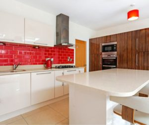 red, clean and tidy kitchen island and worktop that is empty