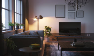 Modern style designed living room interior scene close-up in the winter evening with lamp shining a light