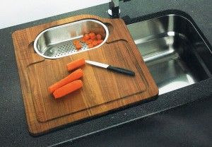 over the sink cutting board with chopped carrots