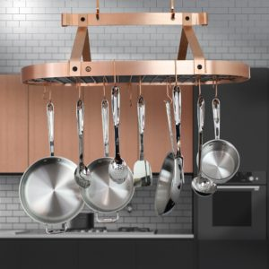 saucepans hanging from the ceiling in a kitchen