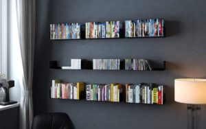 floating shelves on a black wall stored in a teenager's bedroom