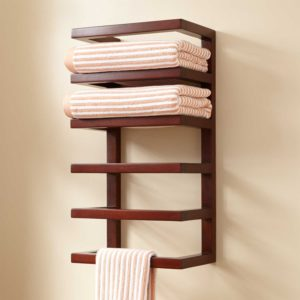wooden towel rack installed on a bathroom wall